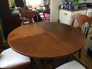 Red Mahogany 48 inch round dining room table and 4 chairs