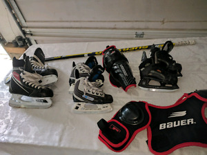 Kids youth hockey skates, stick, shoulder pads, shin pads