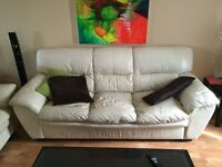 Beige leather couch. (1) 3 seater. (1) 2 seater. (1) 1 seater.