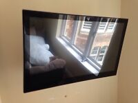37 inchLG TV with wall mount and stand
