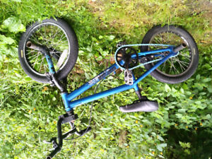 "Bicycle: Haro 16"" wheels blue BMX bike with pegs"