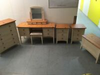 Pine bedroom set. Bedside cabinets, dressing table, ottoman, chest of drawers.
