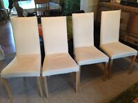Four cream dining chairs with beech legs