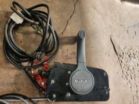 Suzuki Outboard controls boat engine
