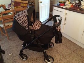 New boxed Silvercross Safari pram/pushchair and changing bag £300 or nearest offer