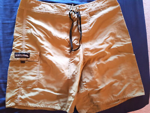 Green Quiksilver board shorts - size 36 EUC