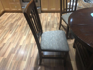 Dining table and 4 chairs .