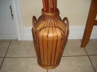 Wicker vase with tall branches