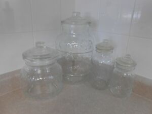 Set of Four Glass Canisters with Lids