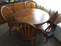 Solid oak round dining table and chairs