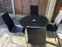 Black Glass Table and Four Black Chairs