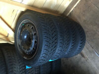 4 WINTER VW RIMS AND TIRES LIKE NEW