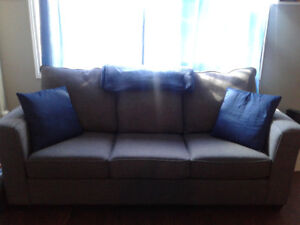 Good Condition 3 seater couch with built in bed - $400 - OBO