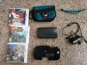 Nintendo 3ds with games, case, and circle pad pro