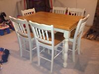 Solid hard wood pub height kitchen table with eight chairs