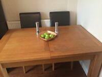 Solid oak extending table with 2 leather chairs