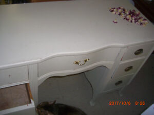Heavy solid wood desk. 2 columns 1 centre drawer. $ lowered