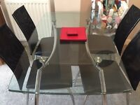 Next glass table and 4 chairs