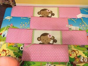 Pink monkey bed protector and baby mobile
