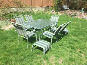 Glass patio table, 6 chairs,2 foot stools