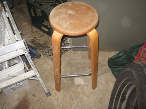 wooden stool about  25 inches high,