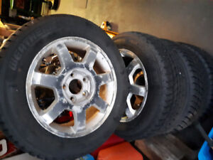 2004 Cadillac rims. with winter tires 215 60 r16.