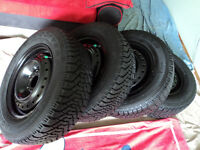 Good Year Nordic 205/65R15 winter tires with full tread and rims