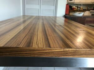 large and modern wood table with metal frame
