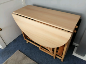Used foldable table and 4 chairs with draw. Light wood