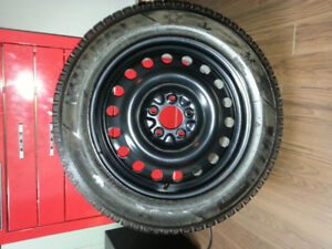 Set of 4 snow tires on rims. Only 4000kms.