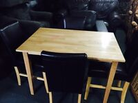 Table and 4 black leather chairs