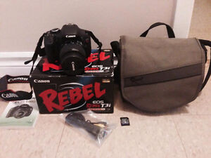 Canon Rebel t3i DSLR Camera with strap,battery, carry bag & card