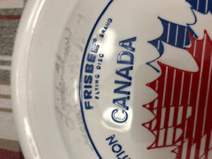 FRISBEE SIGNED BY 9 ATHELITES FROM THE 1984 OLYPICS IN LA