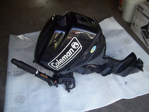 Coleman 9.8 HP outboard motor with fuel tank.