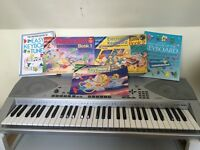 Casio CTK-691 keyboard and music books