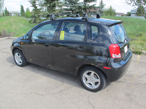 2004 Suzuki Swift with Roof Rack and 2 sets of tires and rims
