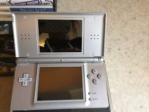 Nintendo ds lite, 10 games and a hard case  London Ontario image 2