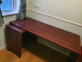 Desk with separate roller section