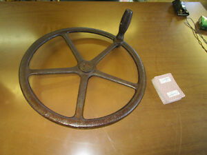 antique cast iron implement steering wheel