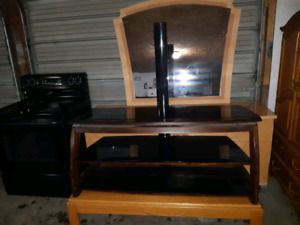 I have a beautiful TV stand made out of wood and glass $