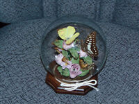 Butterfly in glass dome on wood base