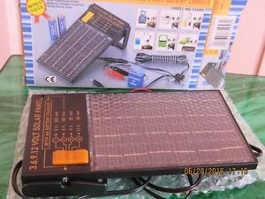 NEW universal Solar battery charger and AC portable adapter West Island Greater Montréal image 2