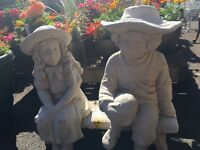 Garden stone boy and girl on beach