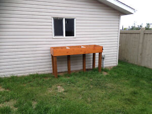 Work bench, filing cabinet, and raised garden FREE
