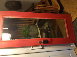 Metal exterior door with electronic keyless entry.