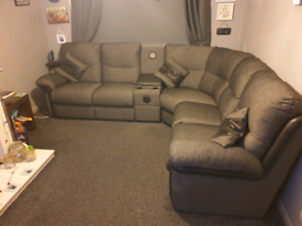 Corner sofa with media centre