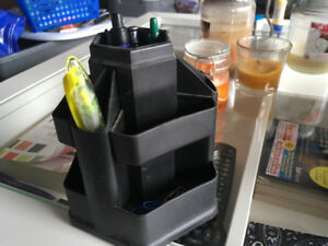 Swiveling pen holder