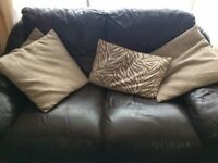 Brown leather suite three seater and two seatet