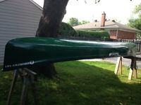 Quessy Country 141 Canoe with paddles and transport cart.