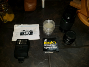 Fujica 80-200mm and 49mm lenses and flash.